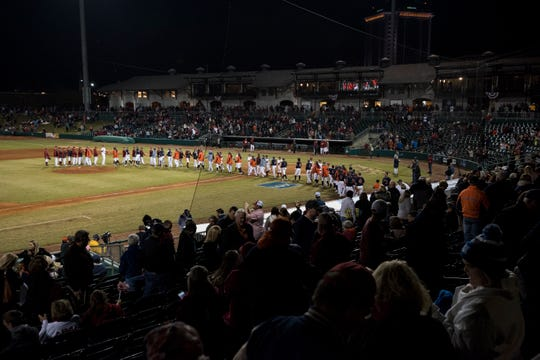 Players shake hands after the Auburn-Alabama Capital City Classic at Riverfront Park in Montgomery, Ala., on Tuesday, March 26, 2019. Alabama defeated Auburn 6-3.