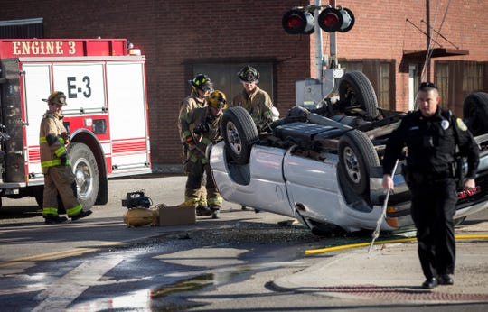 Firefighters and police respond to an accident when a pickup truck struck a guy wire near and flipped on March 27 near West Willard Street and Hoyt Avenue. The driver, found walking  near the crash scene by officers , was taken to IU Health Ball Memorial Hospital for an examination.