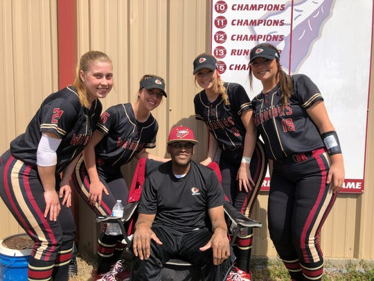 Riverdale assistant softball coach Perry Lyons is surrounded by Lady Warrior players (l-r) Kendall Forsythe, Maggie Dennis, Bree Bailey and Sarah Margaret Lowe at the Southern Warrior Classic tournament on Saturday, March 23.