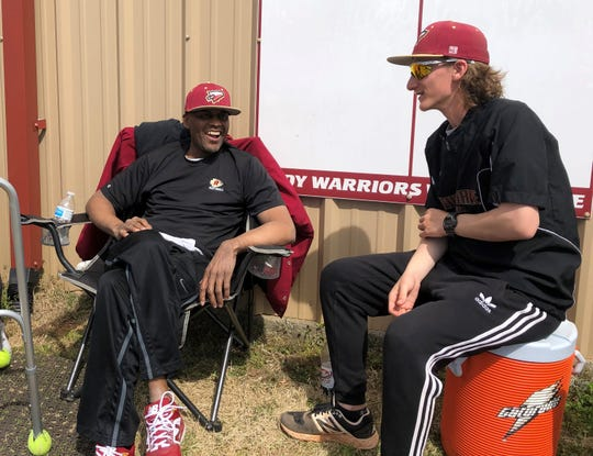 Riverdale assistant softball coaches Perry Lyons (left) and Jace May talk outside the team's clubhouse during the Southern Warrior Classic softball tournament Saturday, March 23. Lyons had a stroke on Feb. 18.