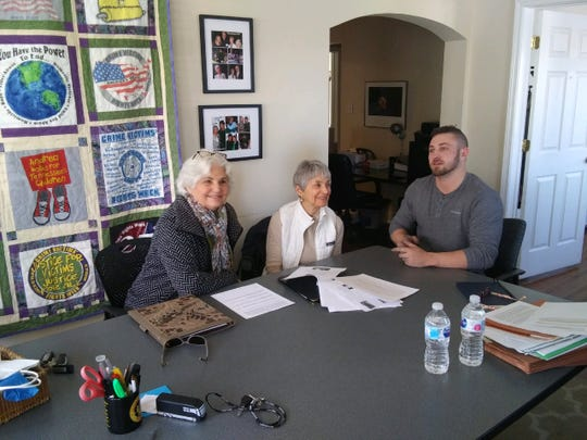 Kelby Smith, right, meets with Andrea Conte, CEO of victims' advocacy agency You Have the Power, center, and Jody Folk, the first director of the victim/witness program in the Davidson County district attorney's office.