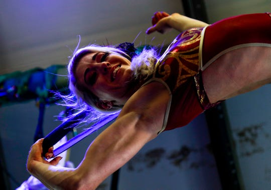 Grace Good practices aerial routines using straps hanging from the ceiling at Nashville Circus Center on March 21.