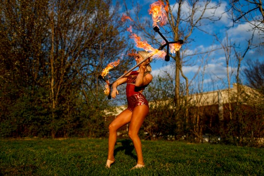 Grace Good performs using a baton lit on fire March 21 at Nashville Circus Center in Brentwood.