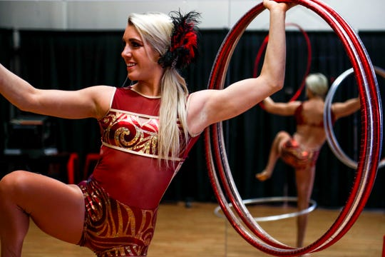 Grace Good balances herself before practicing an act with hula hoops March 21 at Nashville Circus Center in Brentwood.