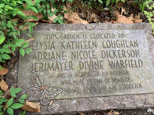 A marker in the Children's Memory Garden in Centennial Park in Nashville honors three children killed by violence in the 1990s.