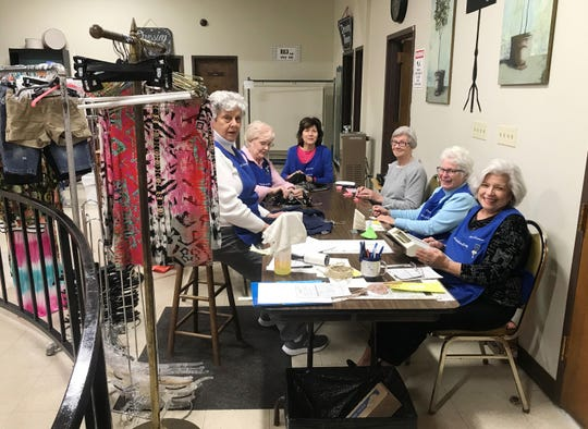 Volunteers do all of the work to get ready for the Ladies of Charity sales. The fall/winter sale opens this weekend.
