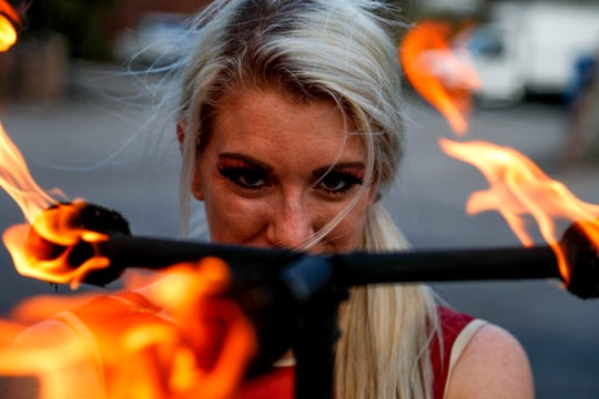 Grace Good strikes a pose with her baton with six points on fire March 21 at Nashville Circus Center in Brentwood.