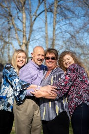 Annemarie Rainwater, Rick Rainwater, Phyllis Rainwater and Adriane Dickson (from left) pose for a photo at their home Tuesday, March 26, 2019, in Shelbyville, Tenn. Rick and Phyllis adopted Annemarie and recently welcomed Adriane back into their home after fostering her.