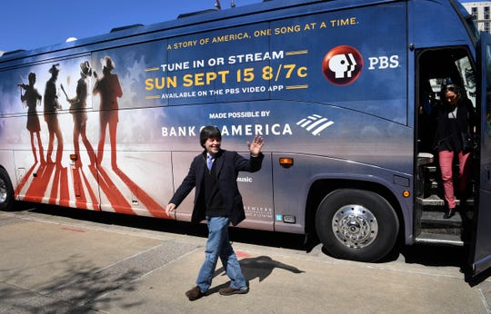 Filmmaker Ken Burns arrives at a news conference March 27, 2019, at the Country Music Hall of Fame and Museum on a bus as it completes the final leg of a six-city tour through Tennessee.
