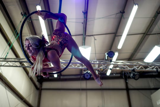 Grace Good uses a hoop suspended from the ceiling to perform aerial acts March 21 at Nashville Circus Center in Brentwood.
