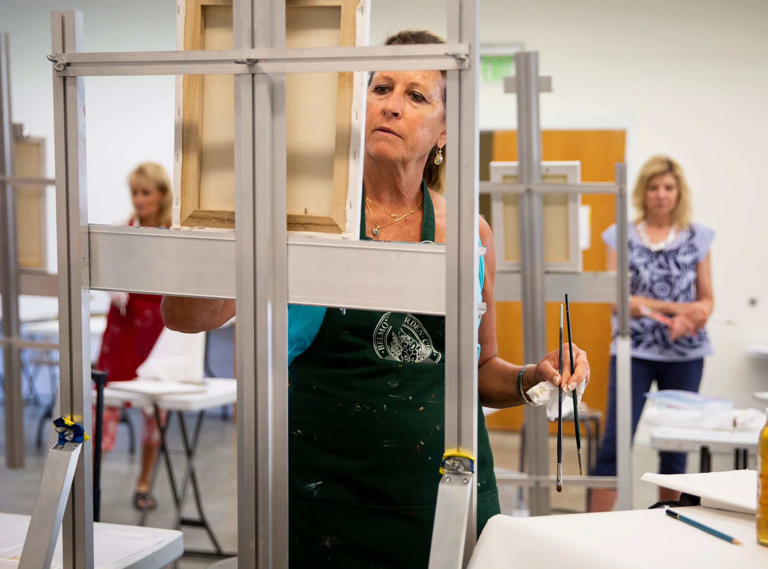 From left to right, Gaby Peden, Maryellen Shea, and Mary Kent follow along with instructor Angela Anderson's directions during a palette knife painting class at the Naples Art Association in Naples on Wednesday, March 27, 2019.