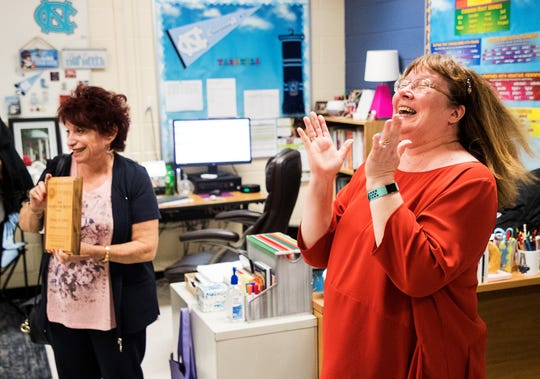 Oakridge Middle School teacher Cindy St. John reacts after being awarded the first-place winner of the Stand Up For Justice grant on Wednesday,March 27, 2019, by Beth Povlow, left, from The Jewish Community Relations Council and  Jewish Federation of Greater Naples and founder of the grant. The award is given to educators for promoting kindness in classrooms.