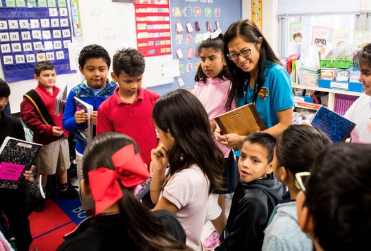 Shadowlawn Elementary School teacher, Phuong Gano stands with her students after being awarded the second-place winner of the Stand Up For Justice grant on Wednesday, March 27, 2019. The award is given by the Jewish Community Relations Council in Naples under the umbrella of the Jewish Federation of Greater Naples. The award is given to educators for promoting kindness in classrooms.