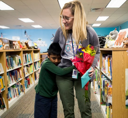 Golden Gate Elementary School school counselor Candace Johnson gets a hug from student Gerson Lopez after being awarded the third-place winner of the Stand Up For Justice grant on Wednesday, March 27, 2019. The award is given by the Jewish Community Relations Council in Naples under the umbrella of the Jewish Federation of Greater Naples. The award is given to educators for promoting kindness in classrooms.