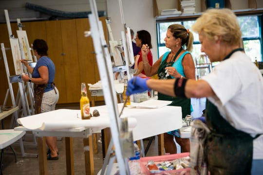 Angela Anderson, left, leads a palette knife painting class at the Naples Art Association in Naples on Wednesday, March 27, 2019.