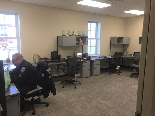 Work stations within the new police headquarters. Previously, the department operated within a 130-year-old structure on South Main Street.
