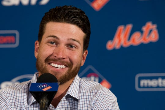 New York Mets pitcher Jacob deGrom smiles during a news conference Wednesday, March 27, 2019, in Arlington, Va.  The Cy Young Award winner and the Mets agreed to a $137.5 million, five-year contract, on Monday, March 25, a deal that includes $52.5 million deferred into the 2030s. (AP Photo/Cliff Owen)