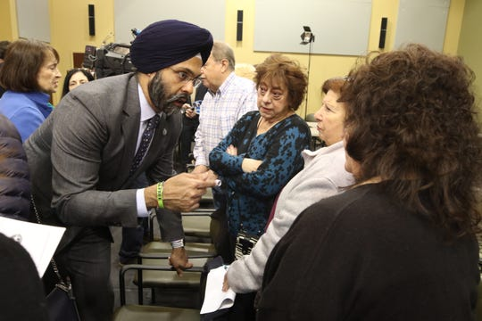Following his press conference Attorney General Gurbir Grewal talks with present and former Pompton Lakes residents about the new lawsuit against DuPont.
