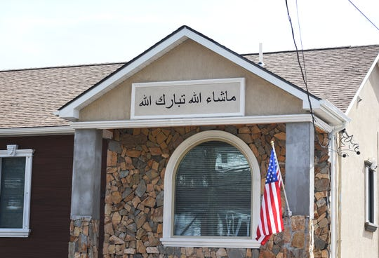 A sign in Arabic on this new home, on Packanack Lake in Wayne, led to dissemination of a racially charged flier throughout the neighborhood.