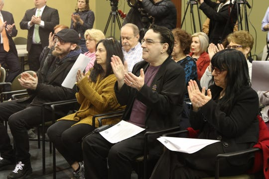 Current and former residents of Pompton Lakes applaud Attorney General, Gurbir Grewal and Catherine McCabe, NJ DEP Commissioner as they announce four new environmental lawsuits for contamination allegedly linked to DuPont including their site in Pompton Lakes at a press conference in Totowa on March 27, 2019.