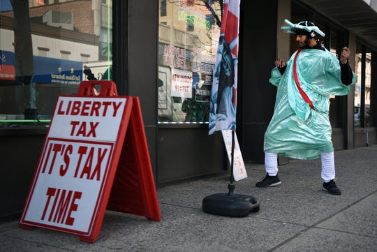 Alexander Jeremy Bernard, 21, dances to South African music while wearing a Statue of Liberty costume on Main Street in Hackensack on March 12, 2019. For the last four years during tax season, Bernard has been a fixture on the street, bringing attention to Liberty Tax, a tax preparation business.
