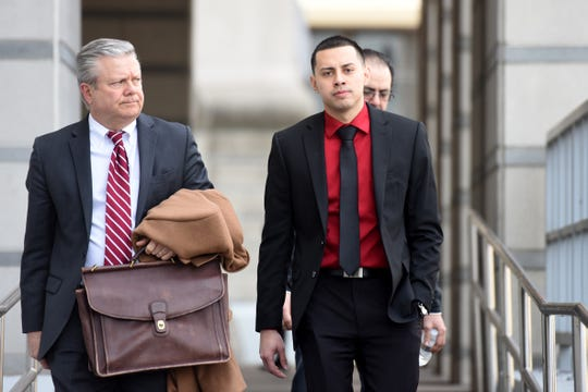 Former Paterson police officer Ruben McAusland, on right, with his attorney John Whipple, on left, was sentenced to 66 months in prison for drug deals he conducted in 2017 and 2018, sometimes while on duty, in uniform and in his police patrol vehicle. McAusland leaves the Federal Courthouse in Newark on Wednesday, March 27, 2019 after being sentenced.