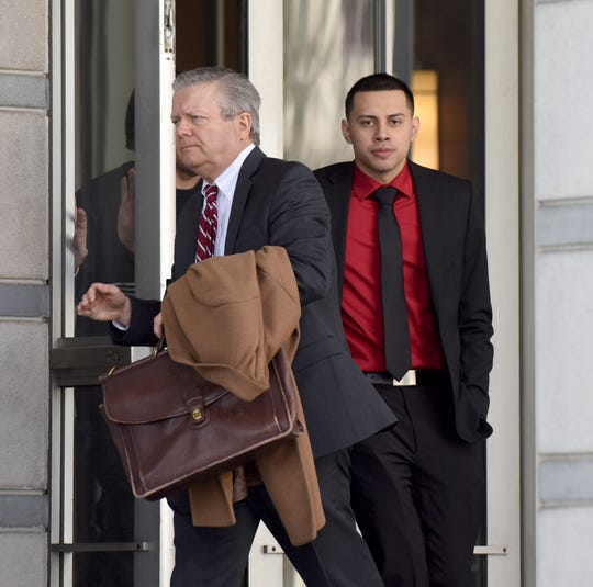 Former Paterson police officer Ruben McAusland, on right, with his attorney John Whipple, was sentenced to 66 months in prison for drug deals he conducted in 2017 and 2018, sometimes while on duty, in uniform and in his police patrol vehicle. McAusland leaves the Federal Courthouse in Newark on Wednesday, March 27, 2019 after being sentenced.