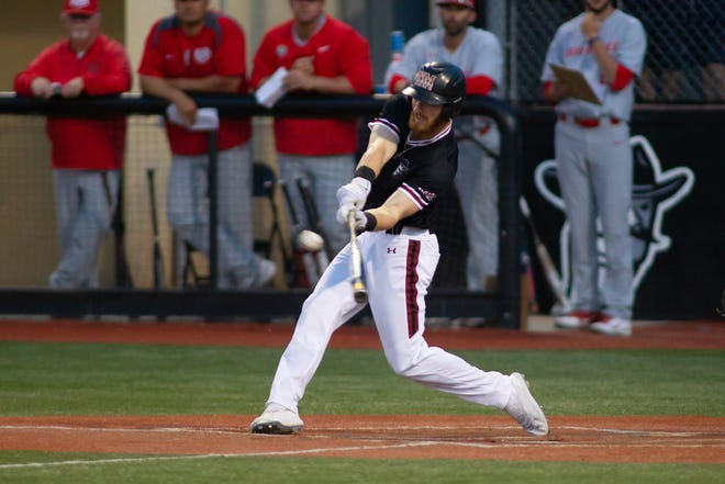 New Mexico State's Noah Haupt connects with the ball for a hit against New Mexico on Tuesday at Presley Askew Field.