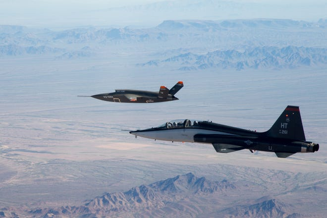 586th Flight Test Squadron T-38 (foreground) provides Safety Chase support to the QX-58A first flight above the Yuma Arizona Proving Grounds on March 5.