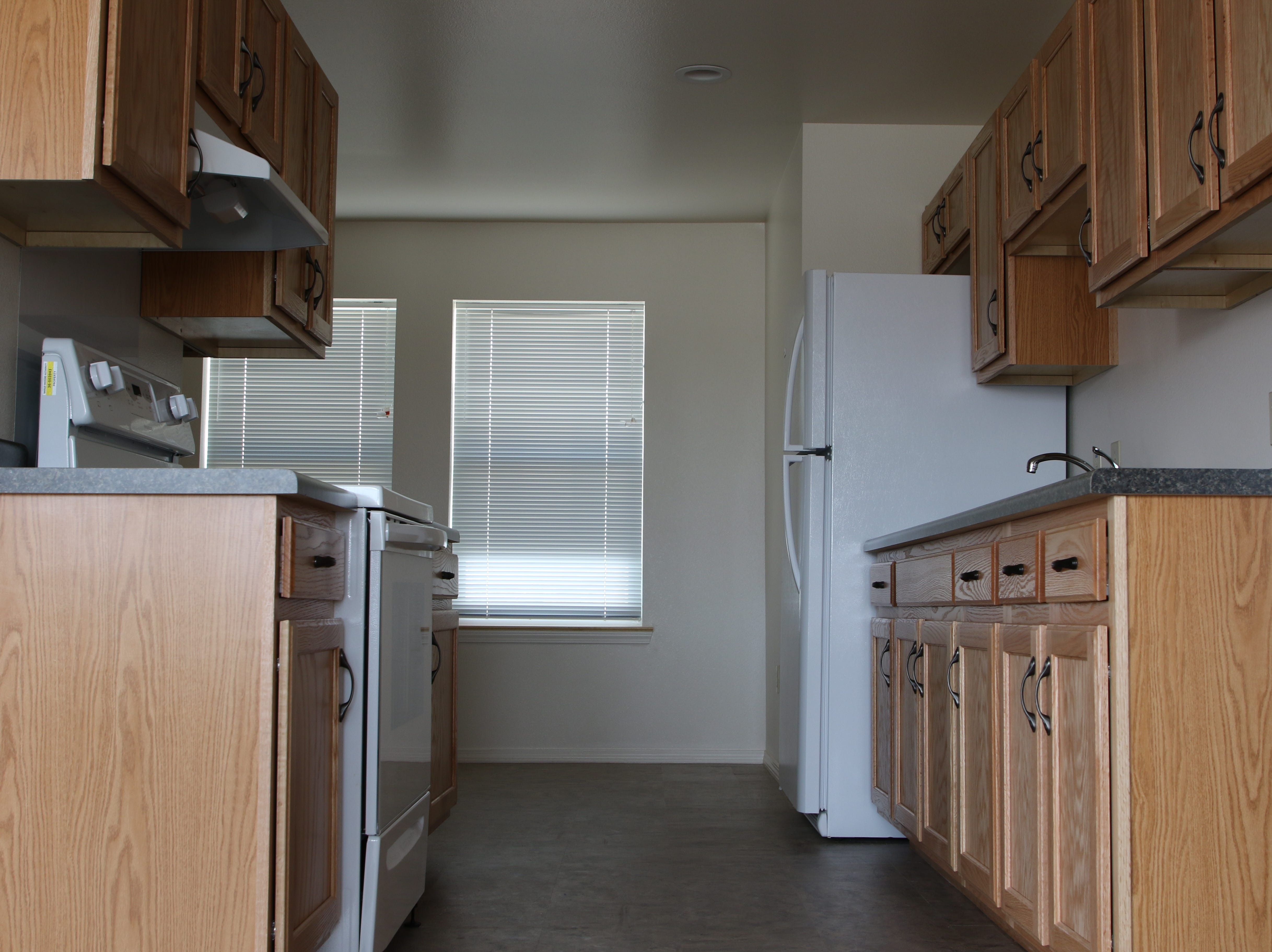 The modernization project for 10 homes in Newcomb included new cabinets and appliances for the kitchen.