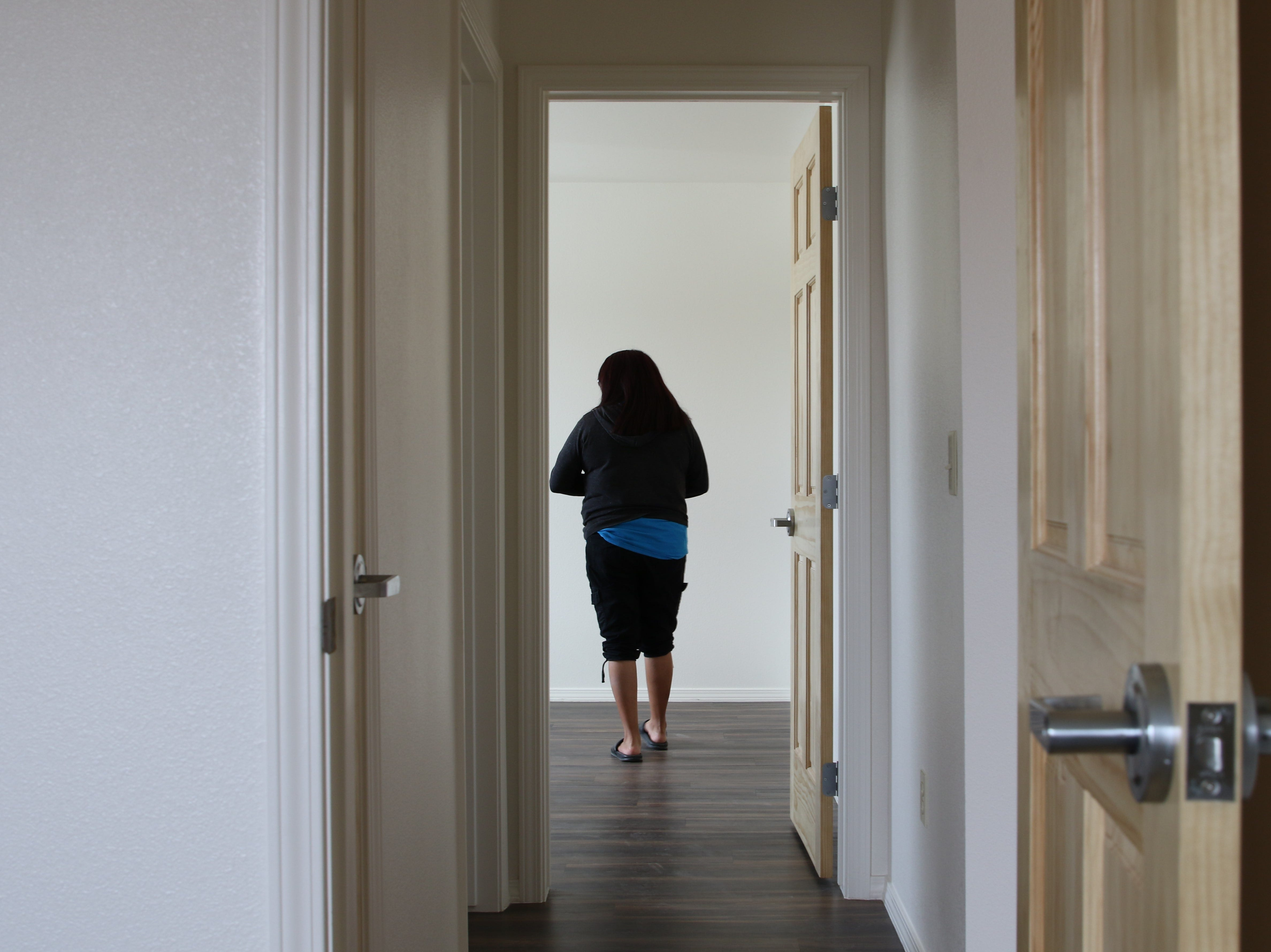 Sheep Springs resident Tasha Nez tours a bedroom on Tuesday inside a home recently modernized by Navajo Housing Authority in Newcomb.
