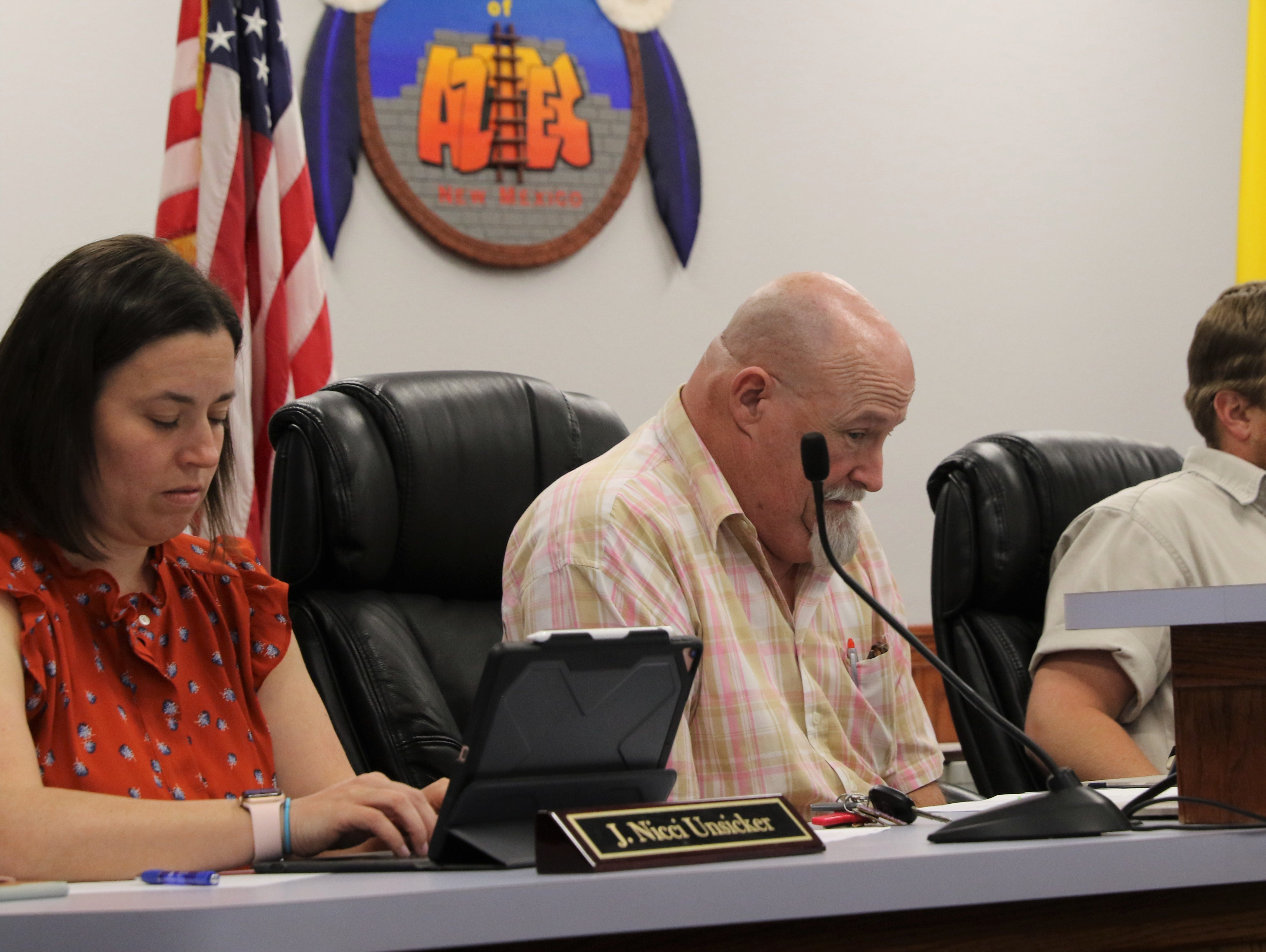 Aztec City Attorney Nicci Unsicker, Commissioner Mark Lewis and Commissioner Austin Randall are pictured, Tuesday, March 26, 2019, during the City Commission meeting.