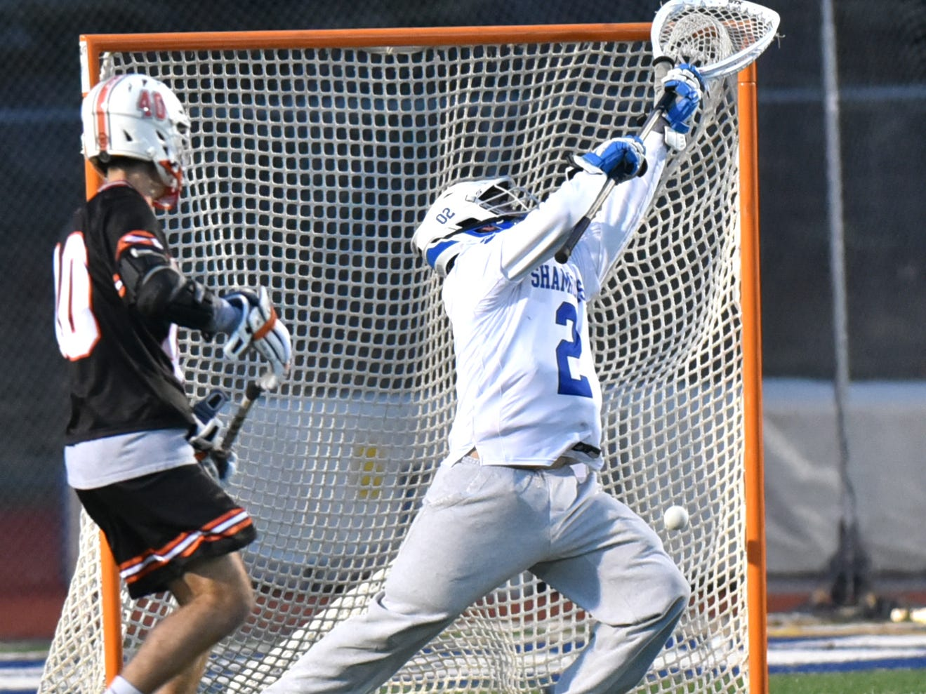 Detroit Catholic Central goalie Johnny Shea, right, misses at the save attempt on a shot by Brother Rice's Jordan Hyde.