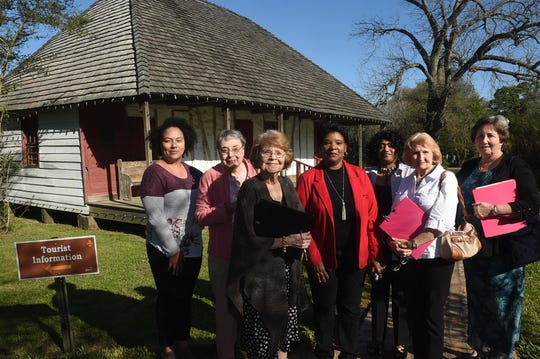 City of Opelousas . representatives Amisha Arceneaux, Delores Guillory and Code Enforcement Officer Margaret Doucet conduct a tour of Le Vieux Village with the judges in town to judge the Cleanest City Contest Wednesday morning.