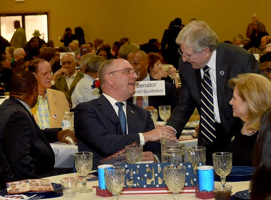 Gov. John Bel Edwards shakes hands with St. Landry Parish Assessor Rhyan Duplechain at the annual St. Landry Democratic Party Lifetime Achievement Banquet.