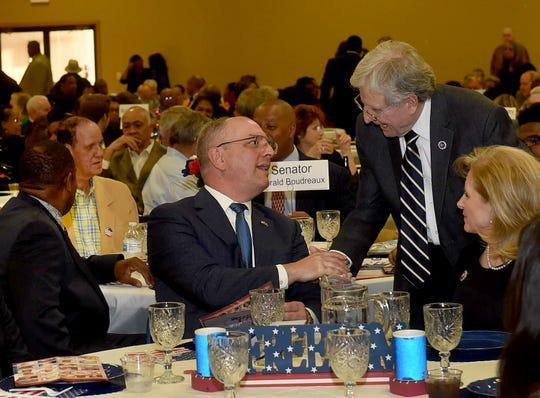 Gov. John Bel Edwards shakes hands with St. Landry Parish Assessor Rhyan Duplechain at the annual St. Landry Democratic Party Lifetime Achievement Banquet.