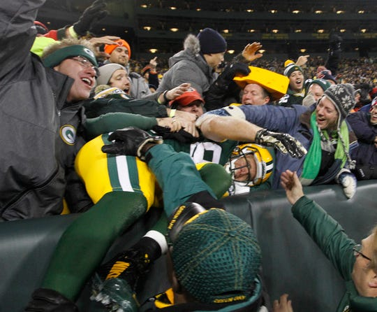 Green Bay Packers wide receiver Jordy Nelson  celebrates a touchdown catch in the first half during the Green Bay Packers-Chicago Bears NFL football game at Lambeau Field in Green Bay, Wisconsin, Sunday, November 9, 2014.