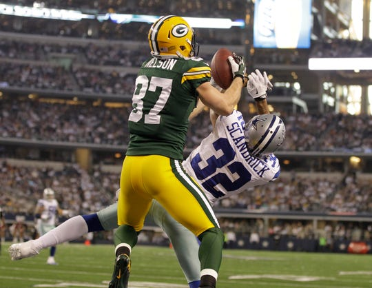 Green Bay Packers wide receiver Jordy Nelson (87) hauls in  a touchdown pass while being defended by Dallas Cowboys cornerback Orlando Scandrick (32) to start the second half during the Green Bay Packers 37-36 win over the Dallas Cowboys, Sunday, December 15, 2103 at AT&T Stadium in Arlington.