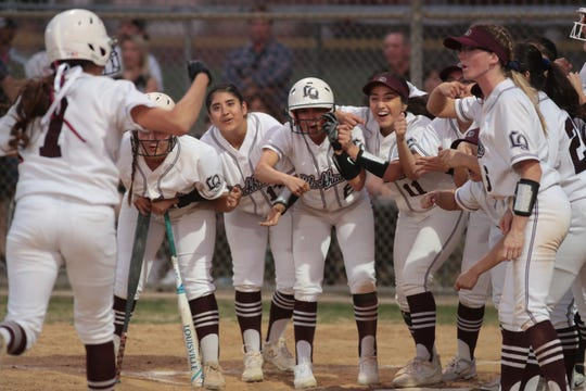 La Quinta cheers in Beatriz Ojeda after her home run against Palm Desert, La Quinta, Calif., March 26, 2019.