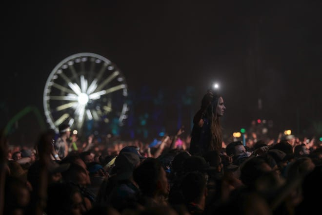 Festivalgoers listen to Odesza perform at the Coachella Valley Music and Arts Festival at Empire Polo Club in  Indio, Calif., April 22, 2018.