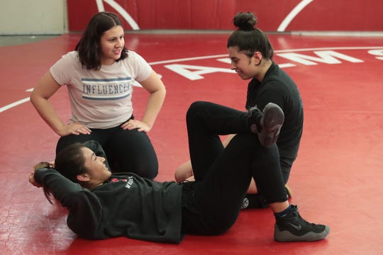 Palm Springs wrestler Cindy Zepeda chats with teammates Karla Garcia, left, and Alice Sanchez after an afternoon practice, Palm Springs, Calif., March 26, 2019.