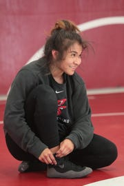 Palm Springs wrestler Cindy Zepeda adjusts her shoes during a practice at Palm Springs High School, March 26, 2019.