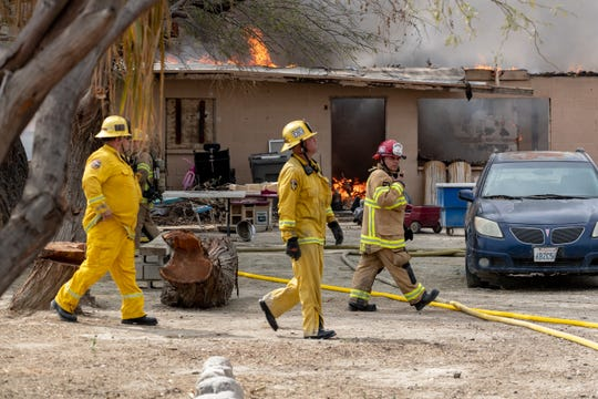 Firefighters battle a house fire off of Jackson Street and Avenue 62 near Thermal.