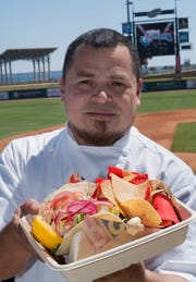 Executive chef Joel Pena with RS3 Strategic Hospitality shows off the variety of food options that will be available at Blue Wahoos Stadium.