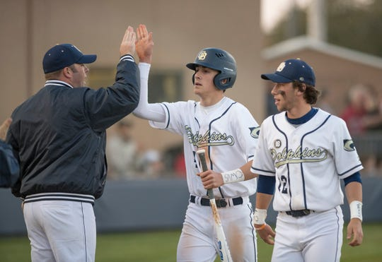 Nik Deweese (No. 4) doubled to cap off a stellar comeback for Gulf Breeze baseball in the first round of the FHSAA playoffs on Wednesday.