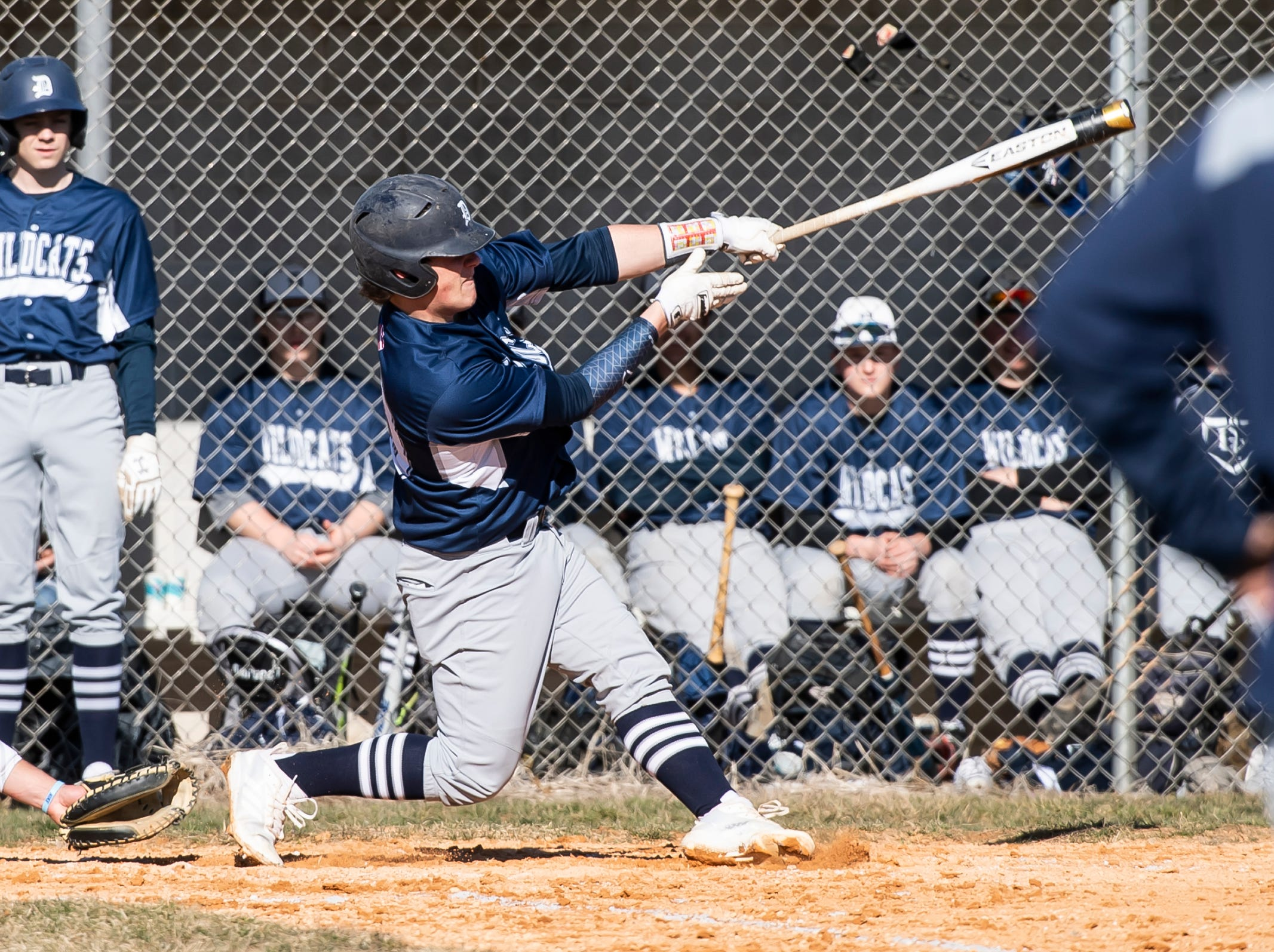 Dallastown's Julian Bailey follows through on his swing on a double during a YAIAA baseball game against Gettysburg on Wednesday, March 27, 2019.