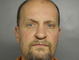 Robert Dell, born on 2/10/1964, 5-foot-11, wanted for contempt of court