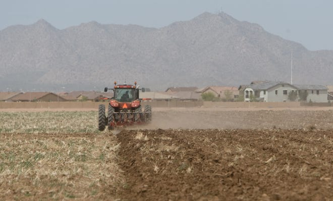 Dust fills the air as a farmer plows a field near Selma Highway in Maricopa, an area included in an area of Pinal County cited for particulate pollution.
