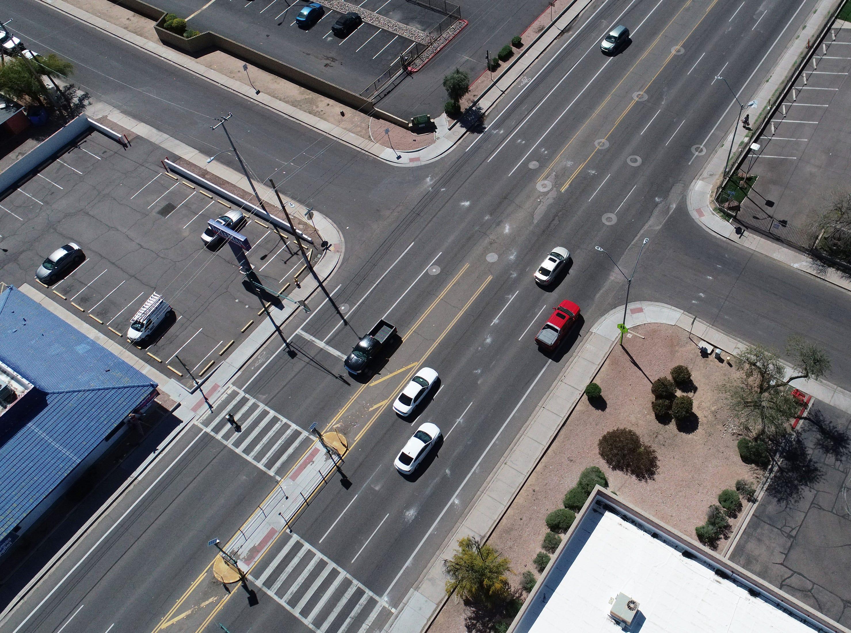 A midblock pedestrian crosswalk is seen on Indian School Road near 20th Avenue in Phoenix.