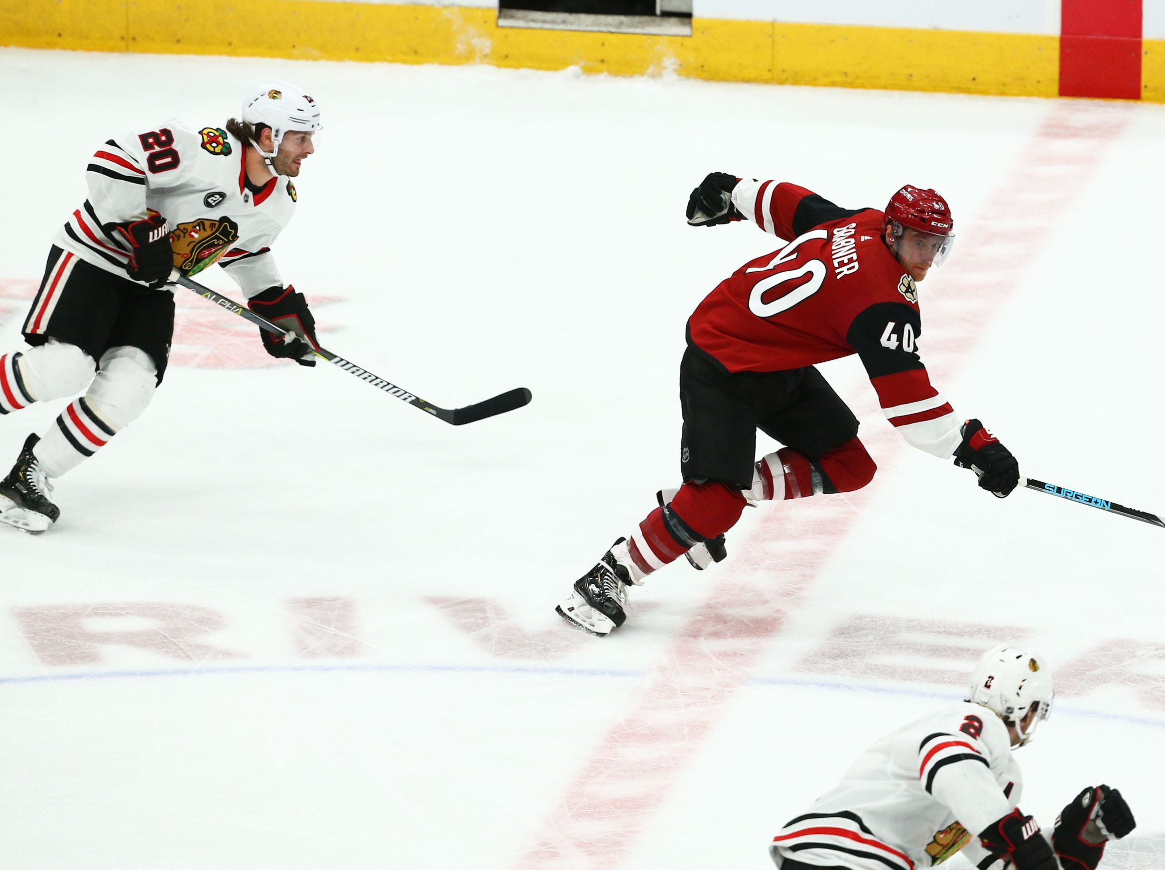 Arizona Coyotes right wing Michael Grabner (40) breaks away from Chicago Blackhawks left wing Brandon Saad (20) in the third period on Mar. 26, 2019, at Gila River Arena in Glendale, Ariz.